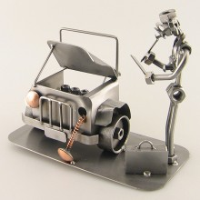 Steelman going over the damages on a totaled car metal art figurine