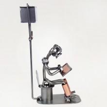 Steelman sitting In the Restroom holding a Tablet PC metal art figurine