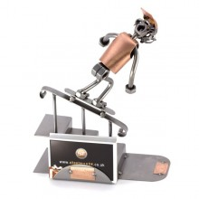 A photo of a Steelman Skateboarder Grinding down a rail metal art figurine with a Business Card Holder