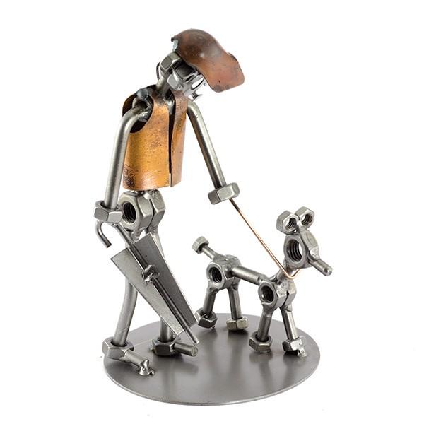 Steelman with his dog on a leash holding an umbrella metal art figurine
